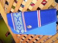 As tiras do panu di terra são usadas para fazer itens como bolsas, carteiras, sapatos, pulseiras